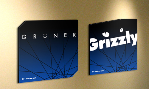 Perfect Wheels Grüner and Grizzly in-store signage